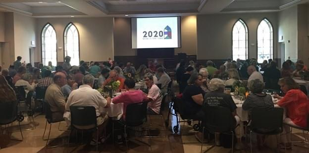 Parishioners gather for a presentation on the 2020 campaign in the parish hall.